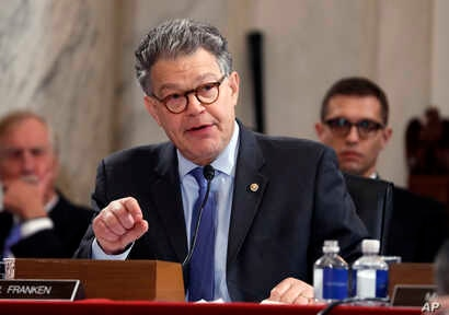 FILE - Senate Judiciary Committee member Senator Al Franken, D-Minn. questions Attorney General-designate, Senator Jeff Sessions, R-Ala., on Capitol Hill in Washington, Jan. 10, 2017, during the committee's confirmation hearing for Sessions.