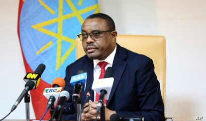 FILE - Ethiopian Prime Minister Hailemariam Desalegn is pictured at a news conference in Addis Ababa, Feb. 15, 2018.  Desalegn stepped down last month amid civil and political unrest across the country; the ruling coalition has elected Abiy Ahmed as ...