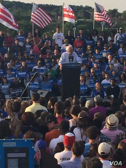 Democratic presidential candidate Bernie Sanders speaks to supporters at a rally in a parking lot at R.F.K. Stadium, in southeast Washington, June 9, 2016.