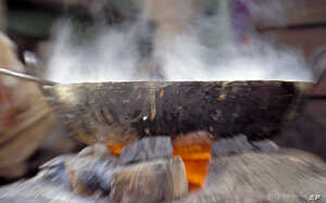 Cooking over an open fire, a common practice in developing countries, raises the risk of heart and respiratory problems