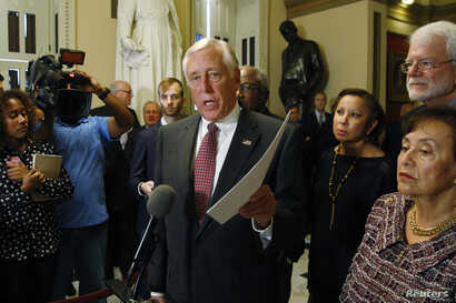 FILE - U.S. House Minority Whip Steny Hoyer is seen speaking to the media at the Capitol in Washington.
