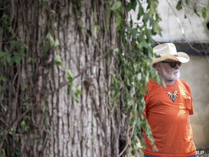Guitarist Dickey Betts, founding member of The Allman Brothers Band, attends Gregg Allman's burial at Rose Hill Cemetery, June 3, 2017, in Macon, Ga.