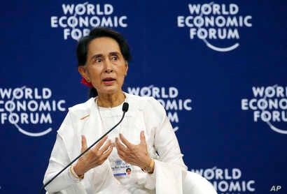 Aung San Suu Kyi, the State Counsellor of Myanmar, gestures during a one-on-one discussion with Berge Brende at the World Economic Forum's meeting at the National Convention Center, Sept. 13, 2018 in Hanoi, Vietnam. Suu Kyi said the country's handlin...