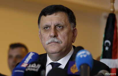 FILE - Libyan prime minister-designate under a proposed national unity government, Fayez Seraj, attends a news conference in Tunis, Tunisia, Jan. 8, 2016.