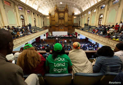 People listen from the gallery as the Constitutional Review Committee hold public hearings regarding expropriation of land without compensation in Pietermaritzburg, South Africa, July 20, 2018.