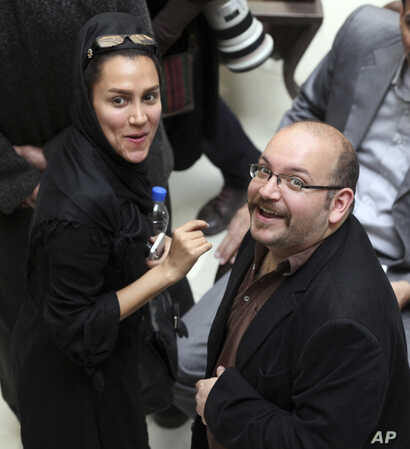 FILE - Jason Rezaian and his wife, Yeganeh Salehi, are shown at a political campaign event in Tehran, Iran, April 11, 2013.