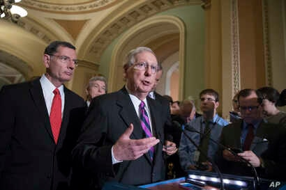 FILE - Senate Majority Leader Mitch McConnell of Kentucky, joined by, from left, Sen. John Barrasso, R-Wyo., and Sen. Roy Blunt, R-Mo., holds a news conference on Capitol Hill in Washington, Aug. 1, 2017.