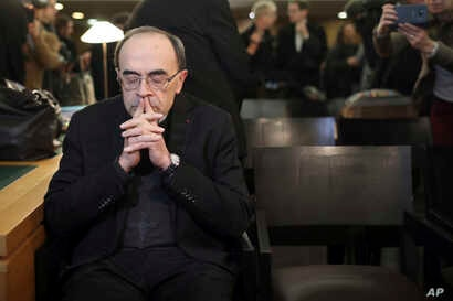 Cardinal Philippe Barbarin waits for the start of his trial at the Lyon courthouse, central France, Jan. 7, 2019.