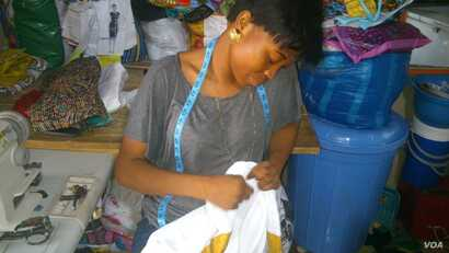 One of iHAVE's dressmakers stitches the seams of a Christmas gift for a needy girl in the city or the rural north (Photo by iHAVE)