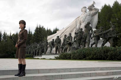 In this Friday, Aug. 17, 2018, photo, a North Korean guide gives a tour of Samjiyon Great Monument in Samjiyon in North Korea.