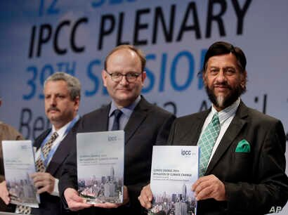 Co-Chairmen of the IPCC Working Group III Ramon Pichs Madruga and Ottmar Edenhofer pose with Rejendra K. Pachauri, Chairman of the IPCC prior to a press conference in Berlin, Germany, April 13, 2014.