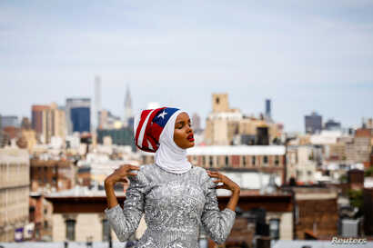 Fashion model and former refugee Halima Aden poses during a shoot at a studio in New York City, Aug. 28, 2017.