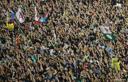 Demonstrators attend a rally in protest of Sunday's election result at a stadium in Kelana Jaya, outside Kuala Lumpur, May 8, 2013.