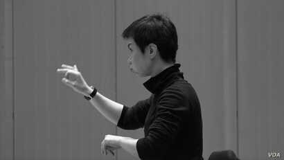 "Conductor Chen Lin rehearses ""Luan Tan"" by composer Chen Qigang at The Juilliard School."