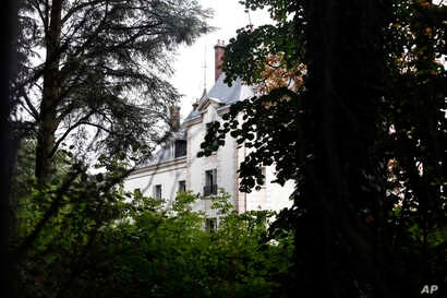 FILE - The manor of Bashar al-Assad's uncle, Rifaat al-Assad, is seen, in Bessancourt, north of Paris, Sept. 13, 2013. The 600-square-meter manor whose real estate portfolio in the Paris region alone is estimated at Euros160 million.