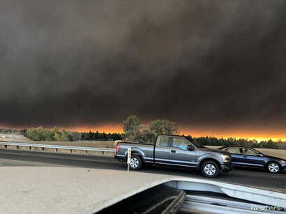 Vehicles are seen during evacuation from Paradise to Chico, in Butte County, California, in this Nov. 8, 2018, picture obtained from social media.
