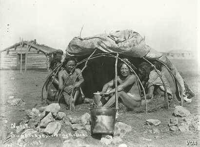 This 1898 photo by an unknown photographer shows a group of Dakota tribe members posing for the camera inside a sweat lodge. The raised coverings indicate that a sweat ceremony is not underway. Courtesy: National Archaeological Archives, Smithsonian ...