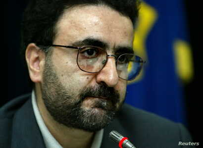 FILE - Mostafa Tajzadeh, a senior member of the reformist Islamic Iran Participation Front, speaks with journalists at a news conference in Tehran, Feb. 21, 2004.