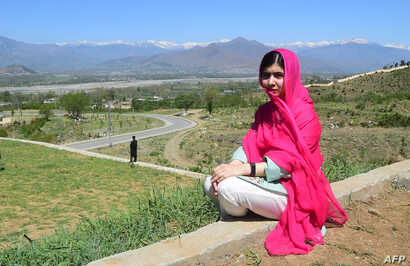 Pakistani activist and Nobel Peace Prize laureate Malala Yousafzai poses for a photograph at all-boys Swat Cadet College Guli Bagh, during her hometown visit, 15 kilometers outside of Mingora, March 31, 2018.