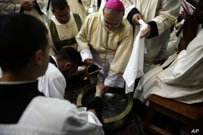 Archbishop Pierbattista Pizzaballa washes the foot of a priest during the Washing of the Feet ceremony at the Church of the Holy Sepulchre, traditionally believed by many Christians to be the site of the crucifixion and burial of Jesus Christ, in Jer...