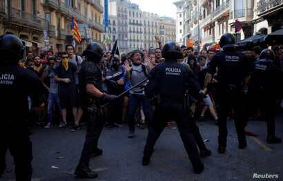 Catalan separatists clash with Mossos d'Esquadra police officers during a protest in Barcelona, Spain, Sept. 29, 2018.