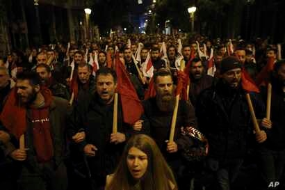 Members of the Communist Party-affiliated labor union shout slogans during a rally in Athens, Jan. 15, 2018. Greek lawmakers, eyeing the end of eight years of bailout programs, approved more painful austerity measures late Monday, as strikes and mass...