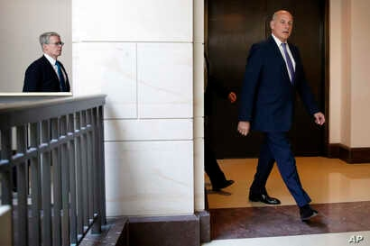 White House Chief of Staff John Kelly, right, arrives for a meeting on the Trump Russia probe, followed by President Trump's lawyer Emmet Flood, left, May 24, 2018, on Capitol Hill in Washington.