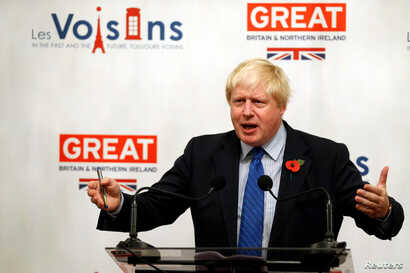 FILE - Britain's Foreign Secretary Boris Johnson gives a speech at the British Embassy during his European tour on Brexit, in Paris, France, Oct. 27, 2017.