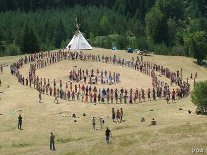 "Dancers and a tipi at the European Rainbow Gathering in Bosnia, 2007. New age movements and Indian ""hobbiests"" have appropriated many elements of Native American cultures and spirituality."