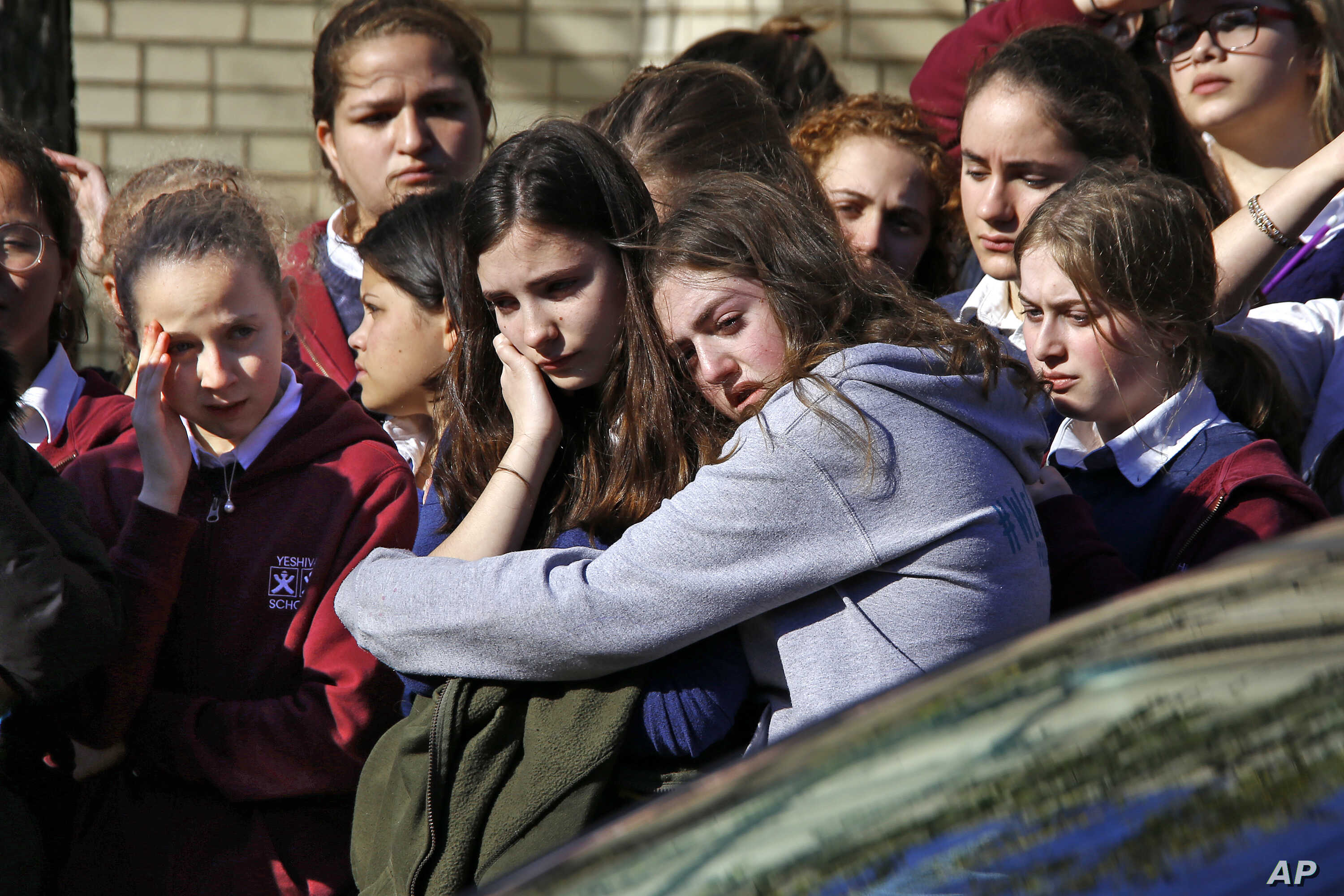 Students from the Yeshiva School in the Squirrel Hill neighborhood of Pittsburgh stand outside Beth Shalom Synagogue after attending the funeral service for Joyce Fienberg, Wednesday, Oct. 31, 2018.