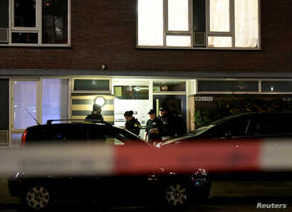 Police officers are seen in front the building where the main suspect of the shooting has been arrested in Utrecht, Netherlands, March 18, 2019.