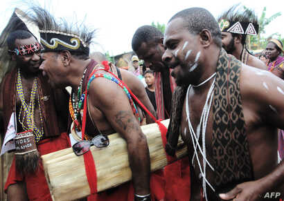 Tribesmen from Indonesia's Papua island participate in a gathering for indigenous communities in Tanjung Gusta, North Sumatra, on March 17, 2017.