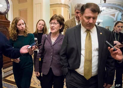 Sen. Susan Collins, R-Maine, left, and Sen. Mike Rounds, R-S.D., leave a meeting in the office of Senate Majority Leader Mitch McConnell, R-Ky., as Day 2 of the federal shutdown drags on, at the Capitol in Washington, Sunday, Jan. 21, 2018.