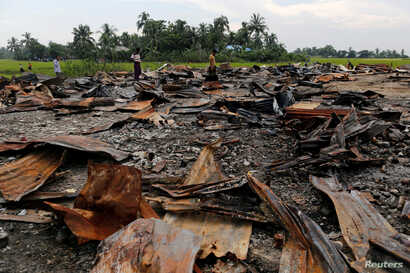 FILE - The ruins of a market that was set on fire are seen at a Rohingya village outside Maugndaw in Rakhine state, Myanmar, Oct. 27, 2016.