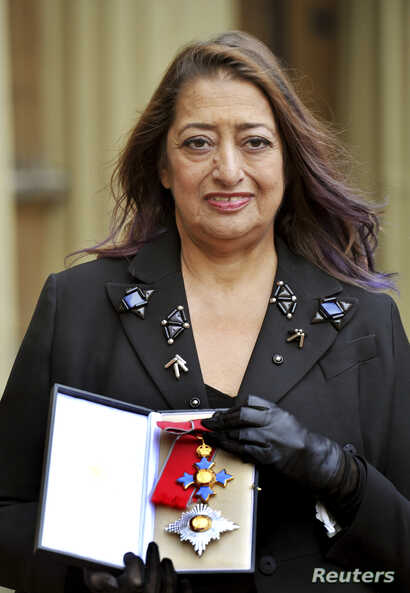 FILE - Architect Zaha Hadid poses for photographs with her Dame Commander of the Order of the British Empire (DBE) medal, after it was awarded to her by Britain's Princess Anne during an Investiture Ceremony at Buckingham Palace, in London, Nov. 7, 2...