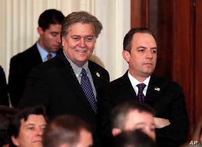 FILE - Steve Bannon, chief White House strategist to President Donald Trump, left, and White House Chief of Staff Reince Priebus stand in the East Room of the White House in Washington.
