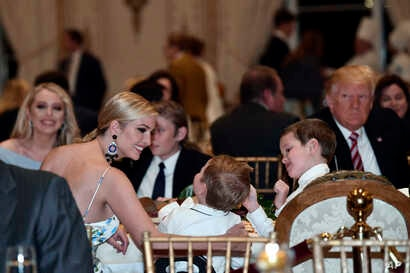 Ivanka Trump talks with her kids as she has Thanksgiving Day dinner at their Mar-a-Lago estate in Palm Beach, Fla., Nov. 22, 2018, with President Donald Trump, left, and sister Tiffany Trump, background left.