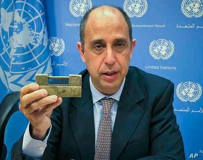 Tomas Ojea Quintana, the United Nations special investigator on human rights in North Korea, holds up a lock given to him by North Koreans who escaped from the country, during a press conference, Oct. 23, 2018, at U.N. headquarters in New York.