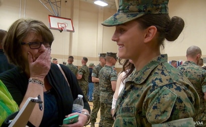 Maria Daume watches her mother, Maureen Daume, become emotional after Maria's graduation from the Marine Corps School of Infantry, March 23, 2017, in Camp Lejeune, N.C. (C. Babb/VOA)