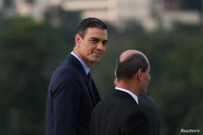 Spain's Prime Minister Pedro Sanchez (L) looks on as he arrives for a wreath-laying ceremony at the Jose Marti monument in Havana, Cuba, Nov. 22, 2018.