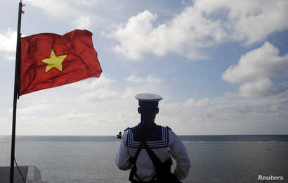 FILE - A Vietnamese naval soldier stands quard at Thuyen Chai island in the Spratly archipelago.