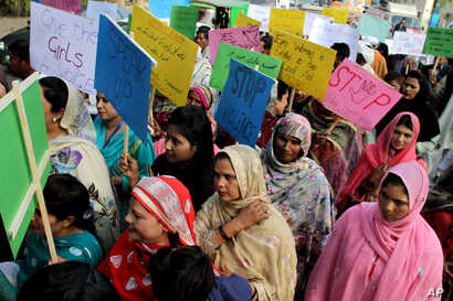 FILE - Pakistani women observe the International Day for the Elimination of Violence against Women, in Lahore, Pakistan, Nov. 25, 2015.