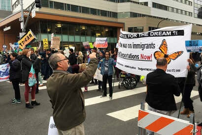 Demonstrators block traffic in front of the hotel where U.S. Attorney General Jeff Sessions was speaking to the California Peace Officers Association meeting, Wednesday, March 7, 2018, in Sacramento, Calif. California Gov. Jerry Brown denounced Sessi...
