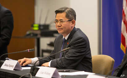 FILE - Zheng Zeguang, Chinese assistant minister of foreign affairs, speaks at a news conference in Chicago, Dec. 18, 2014.