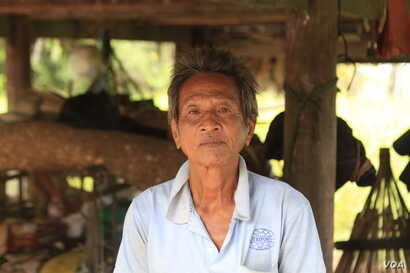 Mey Chham, 69, a resident of Sovong village in Taches commune, was uncomfortable telling his village chief he did not want to join the CPP when she came to his house and asked for photographs of each of his family members to register them in a CPP fa...
