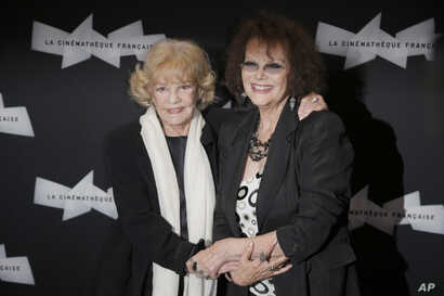 """FILE - French actress Jeanne Moreau, left, and Italian actress Claudia Cardinale arrive for the screening of """"Gebo et l'Ombre,"""" of Portuguese director Manoel de Oliveira at the Cinematheque Francaise, in Paris, Sept. 6, 2012."""