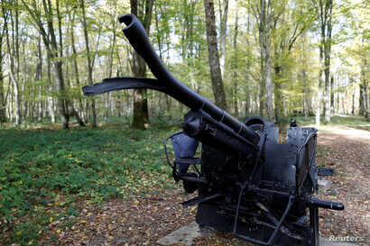 reA damaged cannon is on display in the middle of Belleau Wood behind the Aisne-Marne American Cemetery dedicated to the U.S. soldiers killed in the Belleau Wood battle during the World War I at Belleau, France, Nov. 6, 2018.