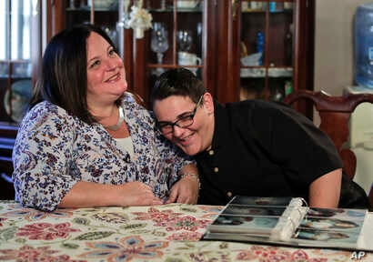 Beth Guardino, left, and her son, Christian, talk about the 17-year-old's life before and after gene therapy treatment for his hereditary blindness during an interview at their home in Patchogue, N.Y., Oct. 2, 2017.