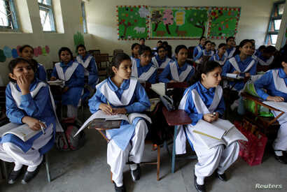 Students listen to their teacher during a lesson at the Islamabad College for girls in Islamabad, Pakistan, Oct. 13, 2017.