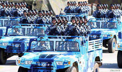 FILE - Soldiers of China's People's Liberation Army (PLA) take part in a military parade at Zhurihe military training base, in Zhurihe, Inner Mongolia Autonomous Region, China, July 30, 2017.